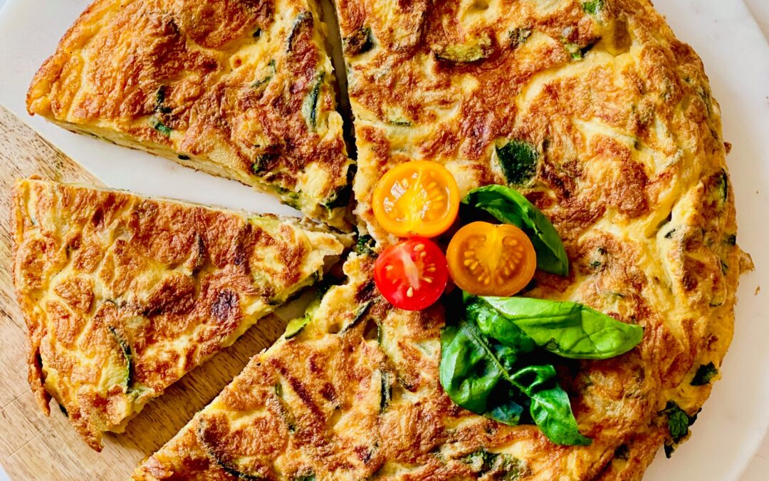 Frittata with courgettes, onion, basil and potatoes.